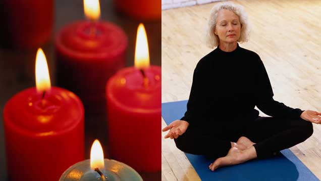 Woman meditating and candles